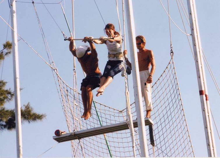 Club Med VP of marketing Sabrina Cendral takes off on a double trapeze.